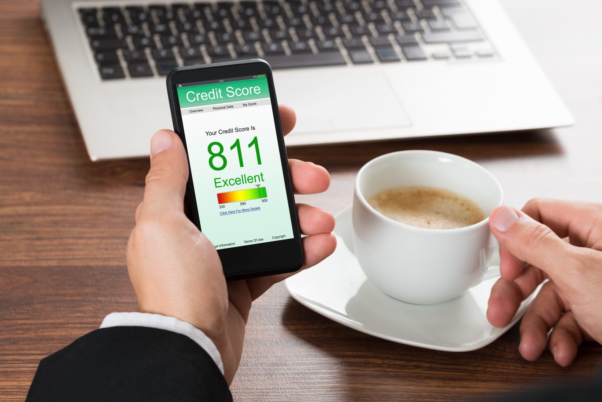 Checking Credit Score Online On Cellphone While Having Coffee. Get your credit score above 800. High Credit Score.